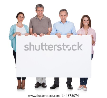 Group Of Happy People Holding Placard Over White Background - stock photo