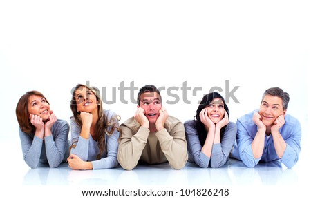 Group of happy people lying on the floor. Isolated over white background.