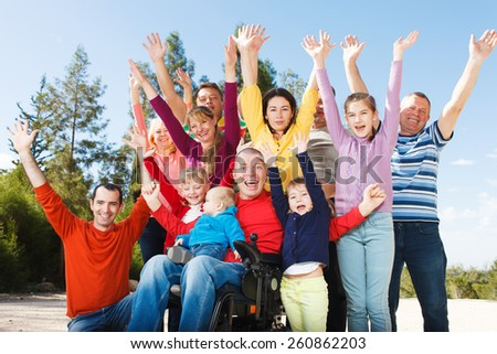 Group of Happy People smiling with hands up.