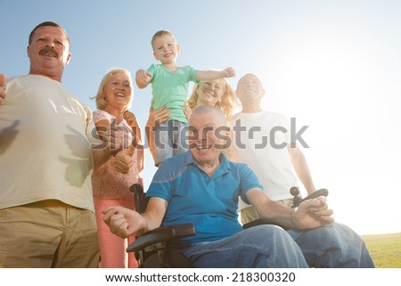 Group of Happy People smiling with thumbs up. - stock photo