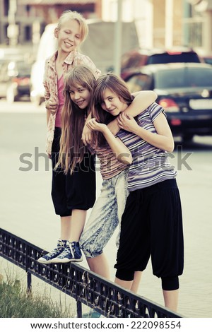 Group of happy school girls on the city street  - stock photo