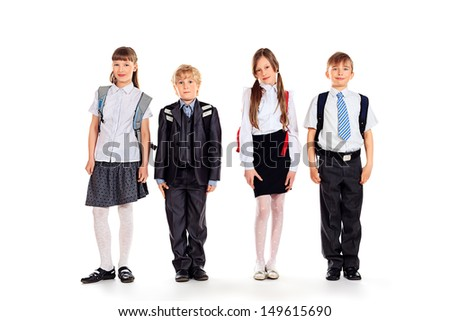 Group of happy schoolchildren standing together. Education. Isolated over white background. - stock photo