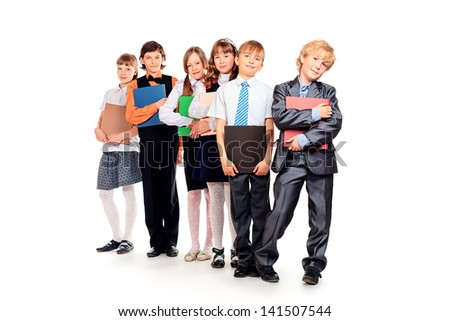 Group of happy schoolchildren with books. Education. Isolated over white background.