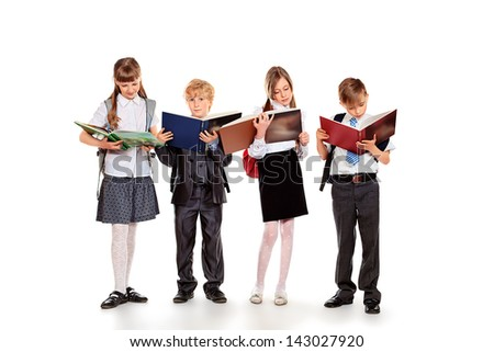 Group of happy schoolchildren with books. Education. Isolated over white background. - stock photo