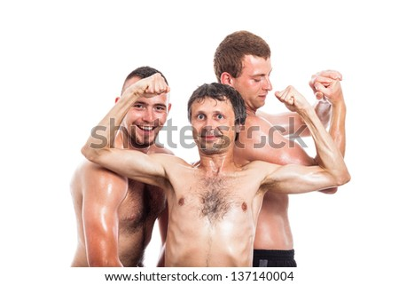 Group of happy shirtless sportsmen showing muscles, isolated on white background - stock photo