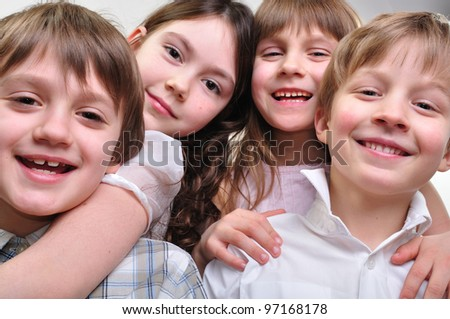 group of happy smiling children friends hugging and playing together - stock photo