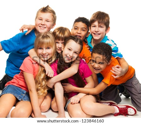 Group of happy smiling kids sitting together and playing - boys and girls black and Caucasian - stock photo