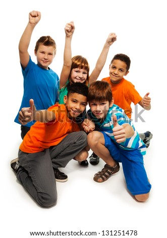 Group of happy smiling kids standing together and playing - boys and girls black and Caucasian - stock photo