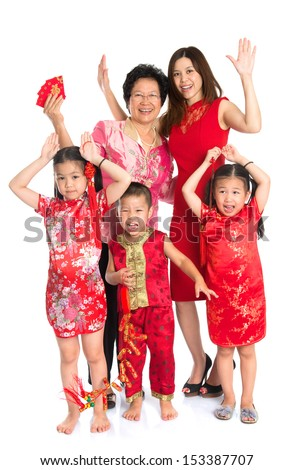 Group of happy  smiling multi generations Asian Chinese family wishing you a happy Chinese New Year, with traditional Cheongsam standing isolated on white background.
