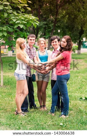Group of happy smiling Teenage Students Outside