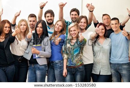 Group of happy students at classroom - stock photo