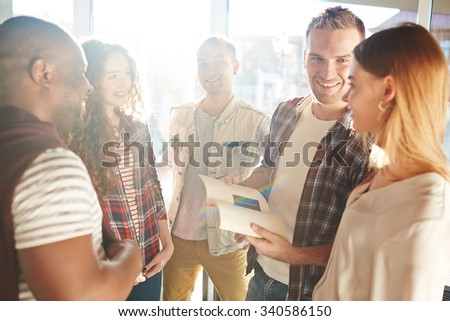 Group of happy students chatting at break - stock photo