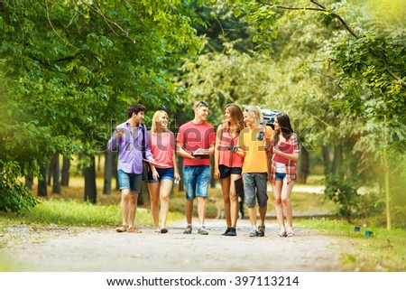 group of happy students in a Park on a Sunny day.. - stock photo