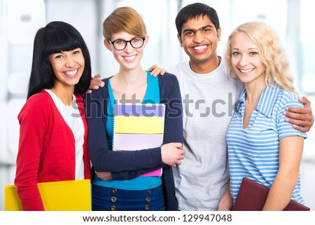 Group of happy students on a white background