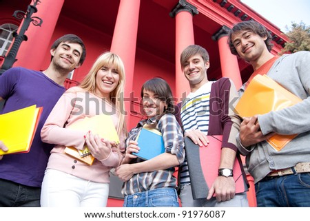 Group of happy students outdoor - stock photo