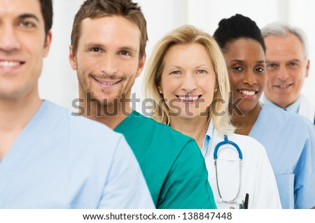 Group Of Happy Successful Doctors Standing In A Row At Hospital - stock photo