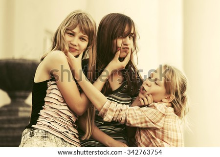 Group of happy teen girls on the city street - stock photo