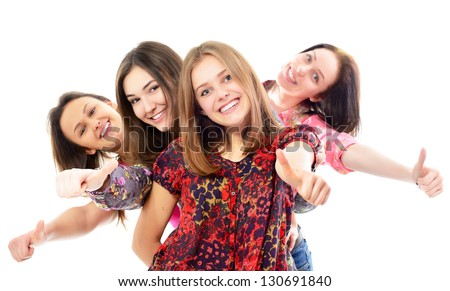 group of happy teen girls with thumbs up, over white background - stock photo