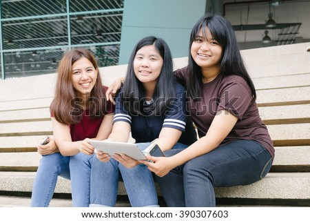 group of happy teen high school students outdoors, Asian, tutoring, Laptop, Tablet