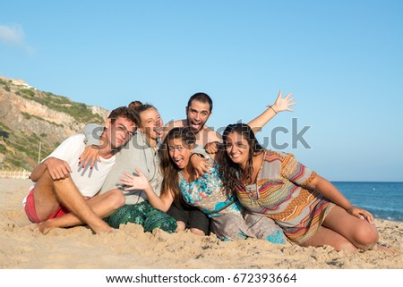 Group of happy teenage friends at the beach