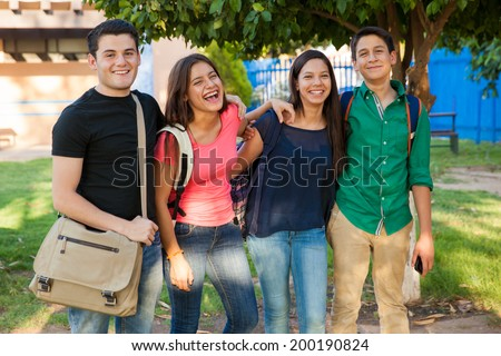 Group of happy teenage friends hanging out and having fun after school - stock photo