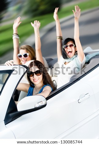 Group of happy teenagers driving the cabriolet. Adorable cabriolet trip on vacation - stock photo