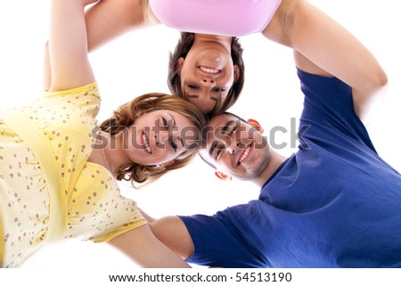 group of happy teenagers in circle â?? view from below - stock photo