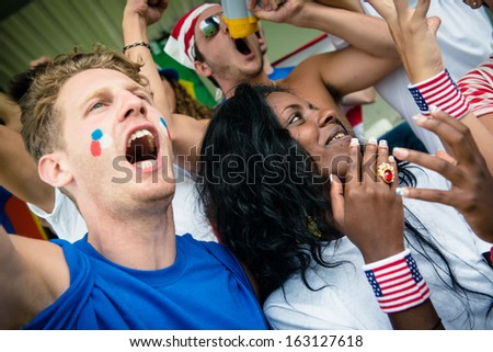 Group of happy USA supporters - stock image - stock photo