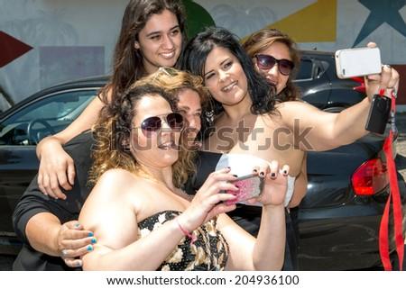 Group of happy women taking a selfie - stock photo