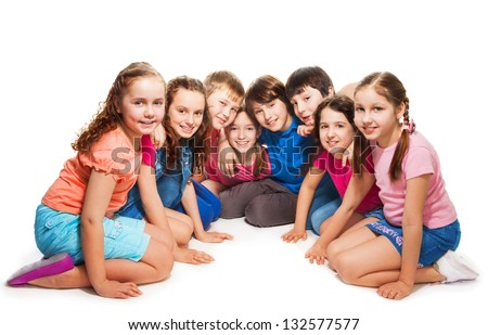 Group of happy 10 years old boys and girls sitting together in semi-circle