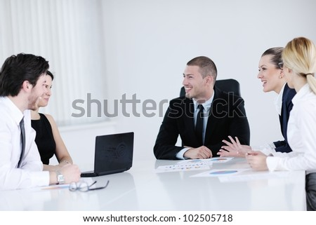 Group of happy young  business people in a meeting at office - stock photo