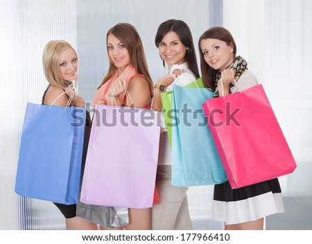Group Of Happy Young Friends With Shopping Bags - stock photo