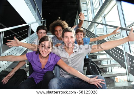 Group of happy young people at university - stock photo