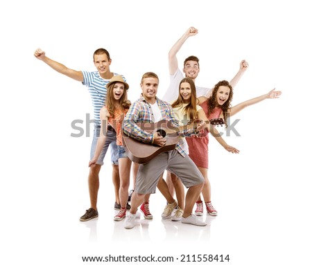 Group of happy young people having fun with guitar, isolated on white background. Best friends - stock photo