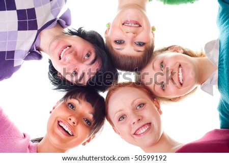 group of happy young people in circle. isolated on white - stock photo