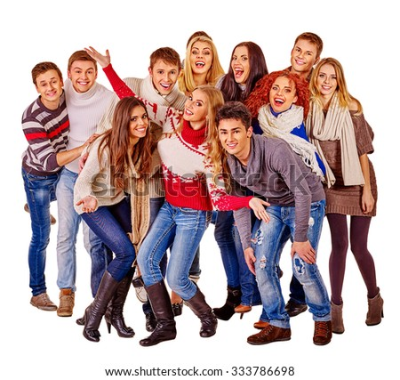 Group of happy young people in warm winter clothes. Isolated. - stock photo