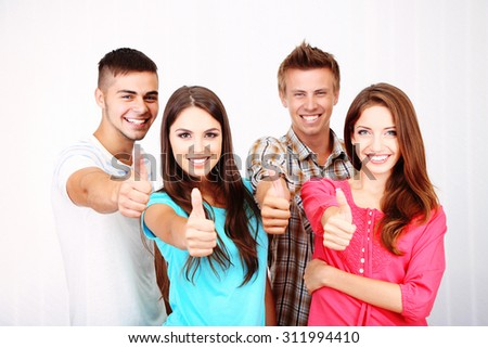 Group of happy young people, indoors - stock photo