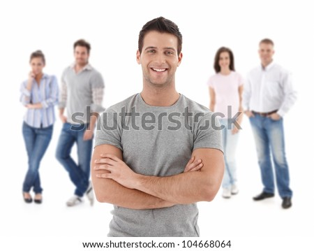 Group of happy young people, smiling man at front, isolated on white background. - stock photo