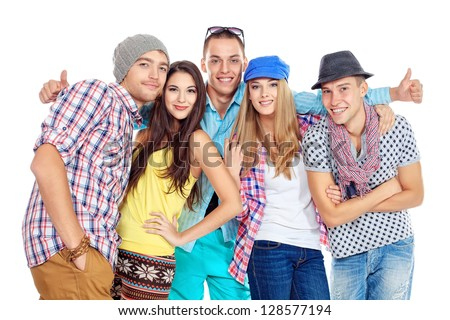Group of happy young people standing together and showing thumbs. Friendship. Isolated over white. - stock photo