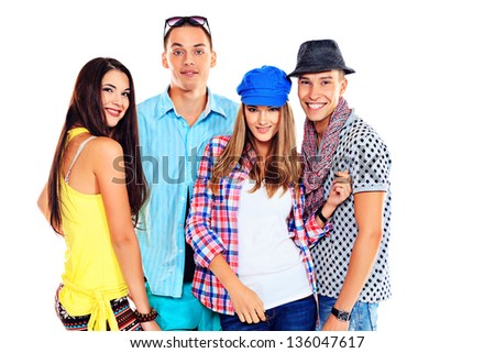 Group of happy young people standing together. Friendship. Isolated over white.
