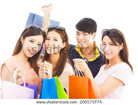 group of happy young people with shopping bags - stock photo