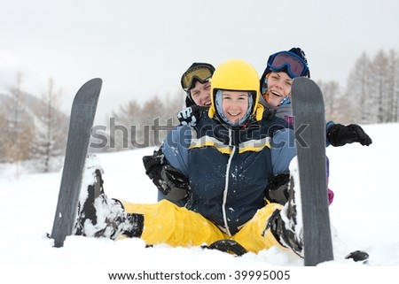 Group of happy, young skiers in the snow - stock photo