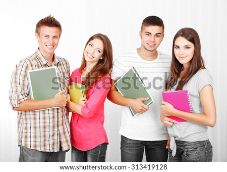 Group of happy young students, indoors - stock photo
