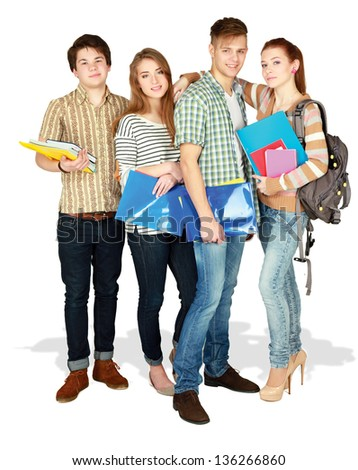 Group of happy young teenager students standing and smiling with books and bags