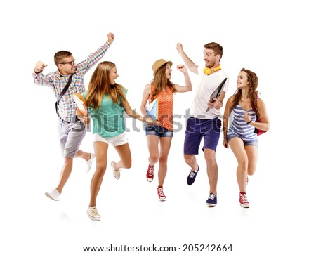 Group of happy young teenager students standing and smiling with books and bags isolated on white background. - stock photo