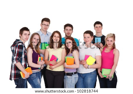 Group of happy young teenager students standing and smiling with books , isolated on white background. - stock photo