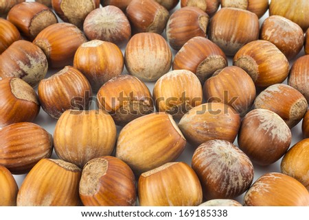 Group of hazelnuts on a flat surface