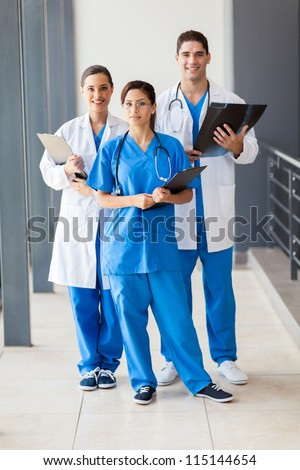 group of healthcare workers full length portrait - stock photo