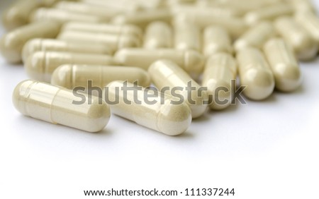 Group of herb capsules on white. RAW/Tiff present - stock photo