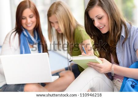Group of high school students sitting floor self educating - stock photo